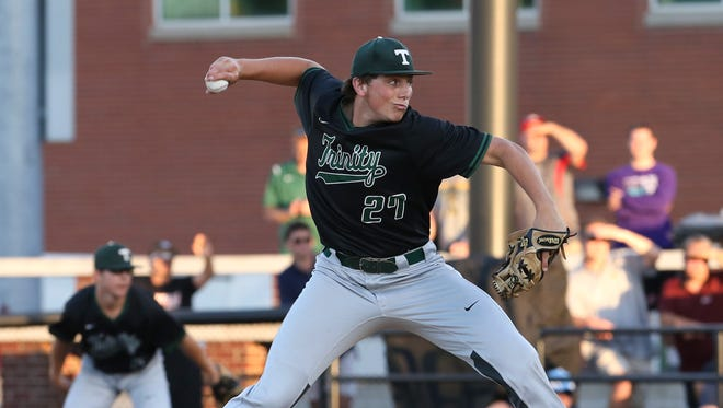 Trinity's Brandon Pfaadt (27) delivers a pitch against St. X during the 7th Region Championship at Patterson Stadium. May 31, 2017
