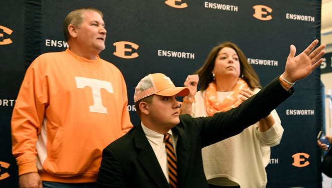 Mark and Nancy Antonutti pose with their son Tanner as he commits to play at Tennessee during early football signing day Wednesday, Dec. 20, 2017 at Ensworth School in Nashville, Tenn.