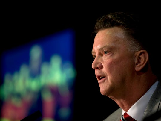 FILE - This is a Thursday July 17, 2014 file photo of Manchester United's new manager Louis van Gaal speaks during a press conference at Old Trafford Stadium, Manchester, England.  The new English Premier League season starts on Saturday Aug. 16, 2014. (AP Photo/Jon Super. File)