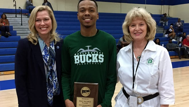 Former Blackman and current Motlow State standout Isaiah Hart (center) was recently named TCCAA/Region VII Tournament MVP. His Bucks will battle in the JUCO national tournament this week.