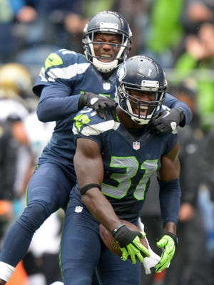 Cornerback Byron Maxwell (31) and safety Kam Chancellor helped the Seahawks generate an NFL-best 39 takeaways.