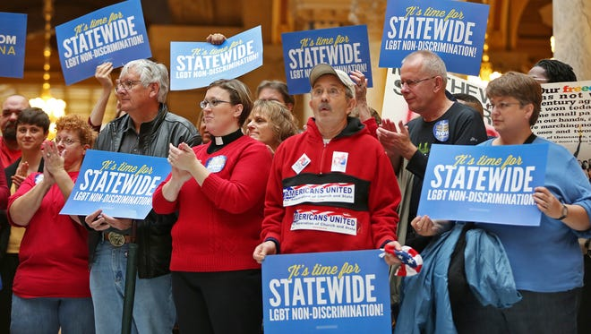 Supporters cheer during the Freedom Indiana rally at the Statehouse, Tuesday, Nov. 17.