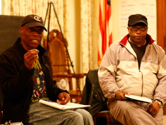 Christopher Norfleet, left, and David Deon Stuart, both of Wausau, attend a People For The Power Of Love meeting.