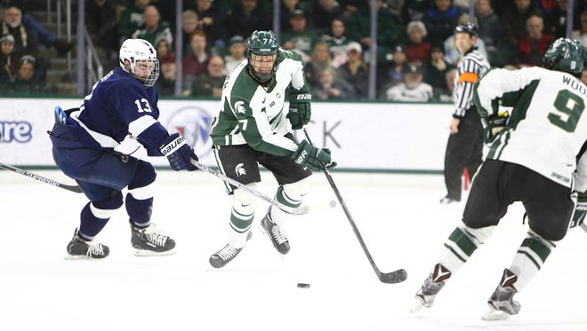 MSU senior John Draeger handles the puck during the Spartans' 6-1 home loss to Penn State Friday night.