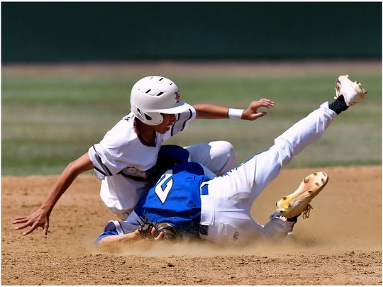Stamford pitcher Zach Duran slides into Hawley baserunner Caleb Comer Saturday May 19, 2018 at Hardin-Simmons University. Comer was declared safe.