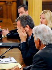 State Rep. Todd Courser composes himself after speaking  to the House Select Committee alongside his attorneys at the Capitol Wednesday 9/9/2015.