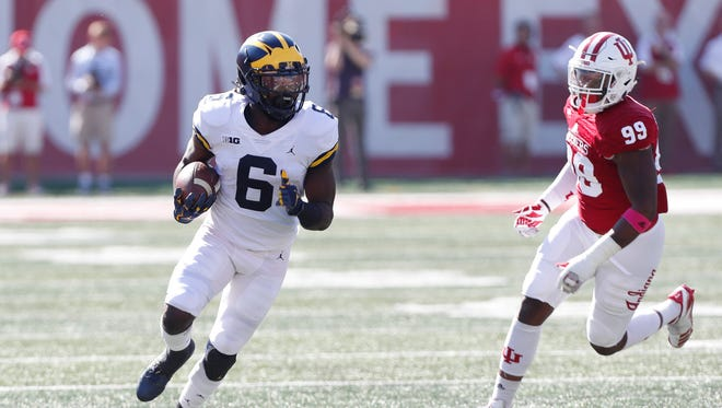 Michigan running back Kareem Walker is chased by Indiana's Allen Stallings IV on Oct 14, 2017 in Bloomington, Ind.