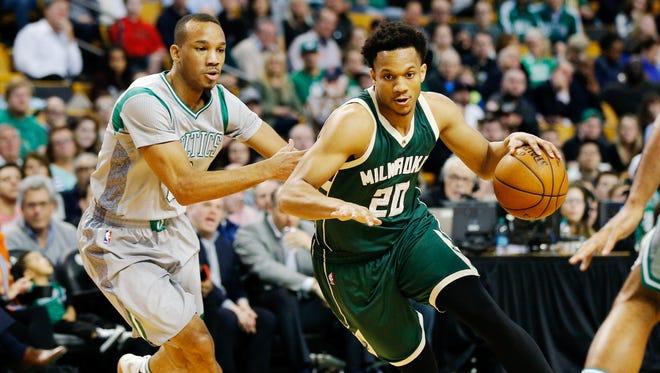 Rashad Vaughn (right) gets past Boston Celtics guard Avery Bradley.