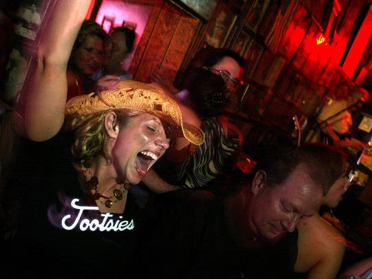 """Nancie Stone of Jacksonville FL. kicks up her heels and yells with the rest of the """"After Hours"""" crowd that hits the bars, including Tootsies."""