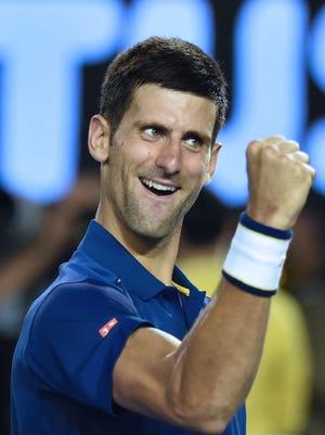 Serbia's Novak Djokovic celebrates after victory in his men's singles semi-final match against Switzerland's Roger Federer during the Australian Open on Jan 28, 2016.