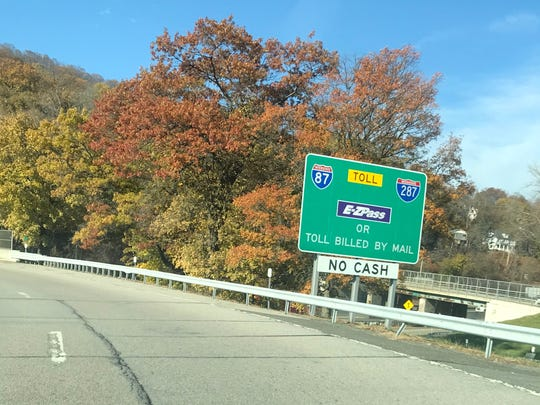 A sign on the South Nyack eastbound Thruway entrance explains tolls are paid via E-Z Pass or mail.