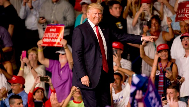 Republican candidate Donald Trump makes his entrance into Germain Arena on Monday, Sept. 19, 2016, in Estero.