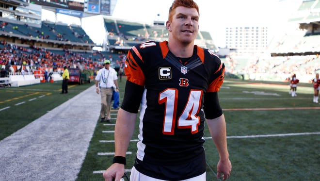 Bengals quarterback Andy Dalton walks off the field after Sunday's 27-24 win.