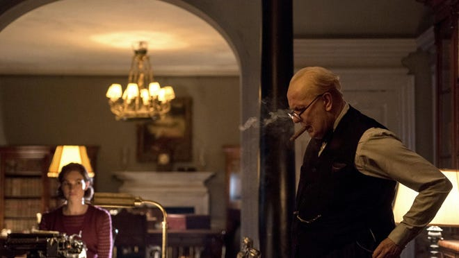 """Lily James and Gary Oldman play characters caught up in the World War II drama """"Darkest Hour,"""" opening Friday."""