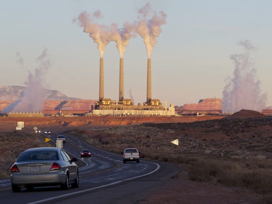 Evaporated water leaves the tops of stacks at the Navajo
