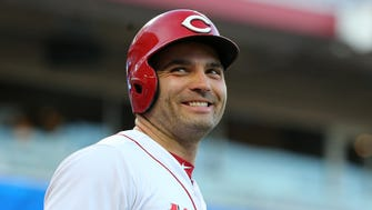 Cincinnati Reds first baseman Joey Votto (19) smiles to the fans while in the on-deck circle in the first inning during a National League baseball game between the Milwaukee Brewers and the Cincinnati Reds, Tuesday, May 1, 2018, at Great American Ball Park in Cincinnati.