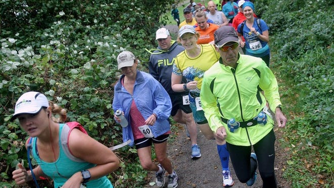 Runners compete in a race going through Old Mill Park in Silverdale.