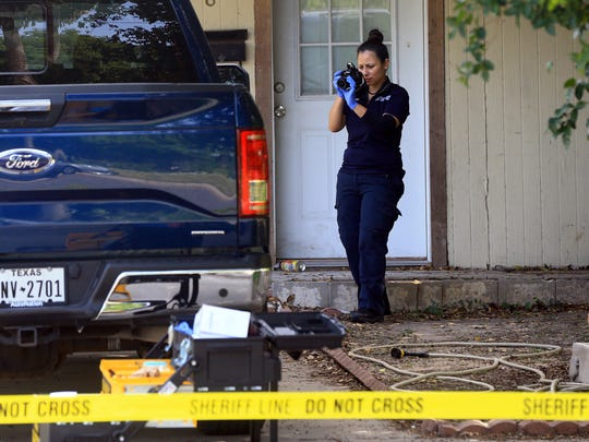 A Kingsville police officer investigates a home after a fatal stabbing was reported on the 500 block of Henrietta Dr. on Saturday, July 1, 2017, in Kingsville.