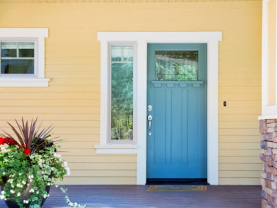 A freshly painted front door can make an immediate impression on a prospective home buyer.
