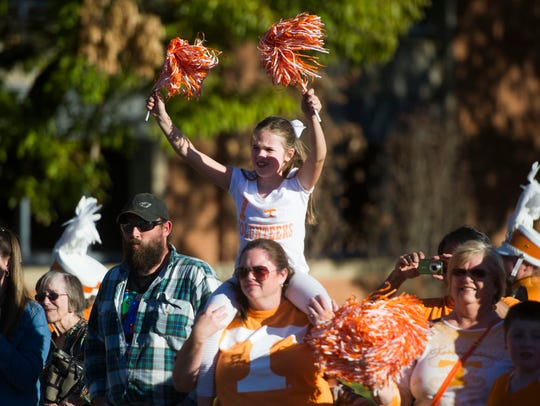 Fans cheer at the 100th UT homecoming parade on Friday,