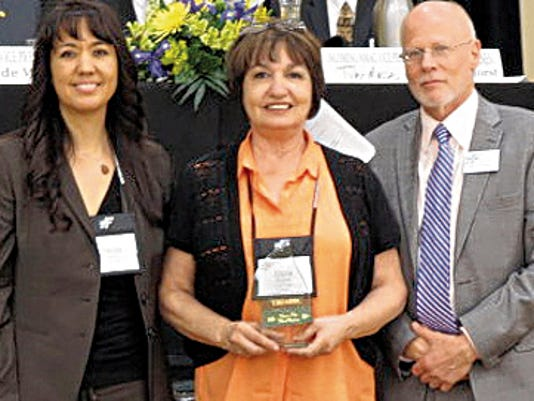 Courtesy Photo   Pictured with Luna County Treasurer Dora Madrid (center) are New Mexico Association of Counties President Paula Garcia and NMAC Executive Director Steve Kopelman.