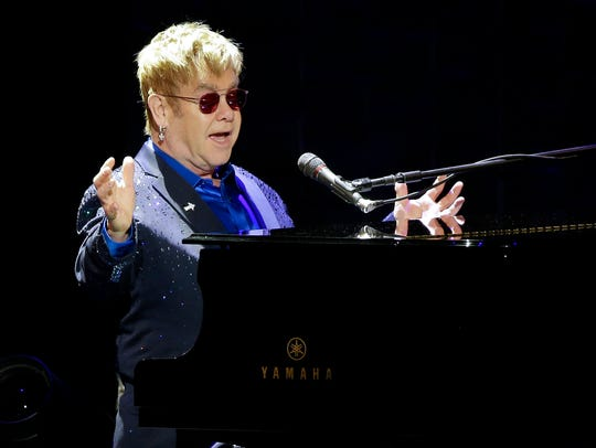 Elton John sings for Hillary Clinton at a rally/concert