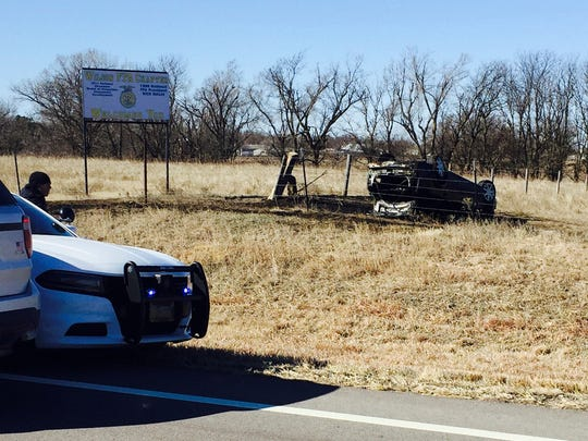 This photo provided by the Kansas Highway Patrol shows an overturned vehicle at the scene following a police chase that ended in a fiery crash Wednesday, March 1, 2017, near Wilson, Kan. The driver, Alex Bridges Deaton, was arrested after the crash. Authorities say Deaton is a suspect in the of shooting of a Kansas convenience store clerk and the kidnapping of two hikers in New Mexico while on the run after his girlfriend was killed and a jogger was shot in Mississippi.