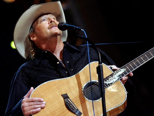 "Alan Jackson performs during ""Country Reaches Out,"" a Grand Ole Opry benefit for the American Red Cross, at the Opry House on Sept. 27, 2005."