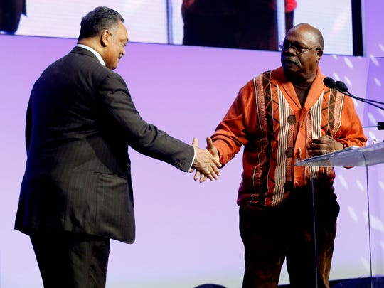 Rev. Jesse Jackson greets Rev. Wendell Anthony, president of the Detroit chapter of the NAACP, before Jackson gave the keynote address during the Let Freedom Ring event in the atrium at Cobo Center in Detroit on Monday, Jan. 15, 2018.