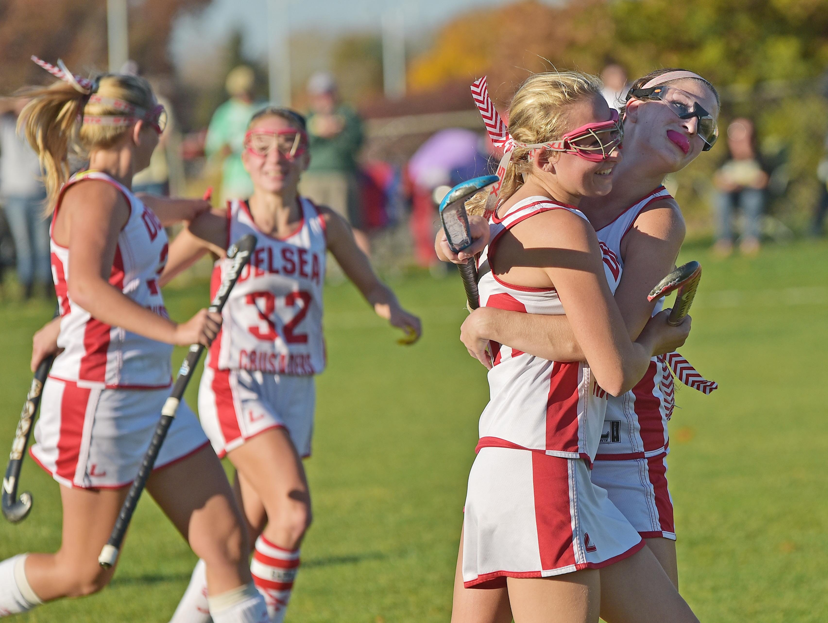 The Delsea Regional High School field hockey team celebrates after defeating Pinelands 3-0 in the Group II South semifinals on Wednesday.