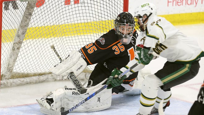 Mamaroneck goalie Tommy Spero makes this stop as Williamsville North's Adam Batz skates in on goal in the semifinal game.