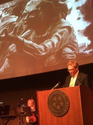 Bruce Landgarten, CEO for the Jewish Federation of the Desert, gives a reading during Yom HaShoah -- or Holocaust Remembrance Day -- at the Eisenhower Medical Center's Annenberg Center.