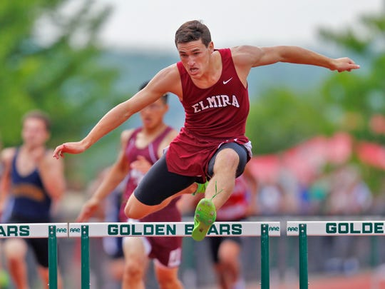 Michael Stearns takes first place during the Section 4 championships in the 400 meter hurdles at Vestal on Thursday.   Thomas La Barbera / Correspondent Photo