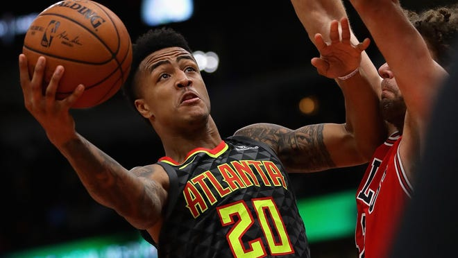 John Collins of the Atlanta Hawks, shown during a 2017 game against the Chicago Bulls, has partnered with the National Basketball Players Association to set up two pop-up grocery stores in West Palm Beach and Palm Beach Gardens.