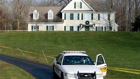 In this file photo a police cruiser sits in the driveway of the home of Nancy Lanza, in Newtown, Conn. The Colonial-style home where Newtown school shooter Adam Lanza lived with his mother has been transferred to the town in a deal with a bank. Nancy Lanza was killed there by her son before he forced his way into Sandy Hook Elementary School, Dec. 14, 2012, in Newtown, where he killed 20 first-graders and six educators. The future use of the house and property will be decided later.