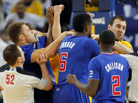 FILE - In this Dec. 25, 2013, file photo, Los Angeles Clippers power forward Blake Griffin, left, fights with Golden State Warriors center Andrew Bogut, right, as Clippers center DeAndre Jordan (6) and Darren Collison (2) look on during the second half of an NBA basketball game in Oakland, Calif.  The alley-oops in Lob City, the deep 3-pointers by the Splash Brothers and the overall bitterness between the Los Angeles Clippers and Golden State Warriors should make for one of the most entertaining series in the first round of the NBA playoffs. Whether the up-and-down style both teams play can carry either to a championship this year or in the future remains a topic of debate. (AP Photo/Tony Avelar, File)