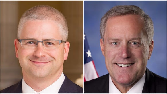 U.S. Reps. Patrick McHenry, left, and Mark Meadows,