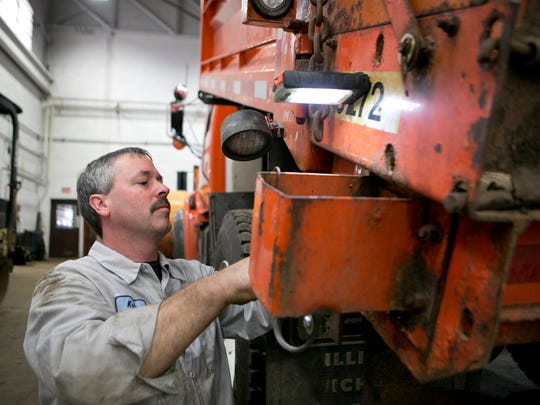 Welder and fabricator Keith Bohmsach works on hooking up the sensor for the auger on a snow plow at the Wood County Highway Department in Wisconsin Rapids, Wednesday, Nov. 18.