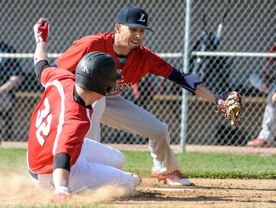 Annville-Cleona's Mitchell Long slides under the tag