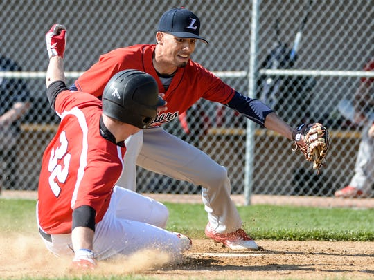 Annville-Cleona's Mitchell Long slides under the tag of Lebanon's Michael Deleon on a passed ball to score A-C's second run .