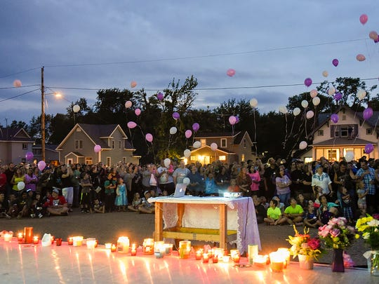 Balloons are released Tuesday during a candlelight vigil to remember Alayna Ertl at St. Anthony Catholic Church in Watkins.