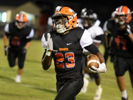 South Gibson's Dre McAllister runs toward the end zone