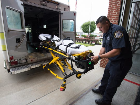 Joe Maker, assistant employee supervisor, with Volunteer Hose Company, Station 27 in Middletown pulls the stretcher from their ambulance.
