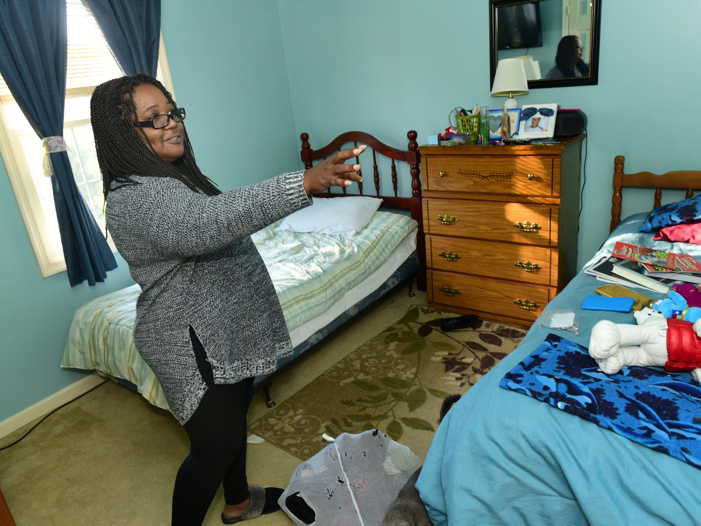 Lydia Dupree walks through the room of one of her foster