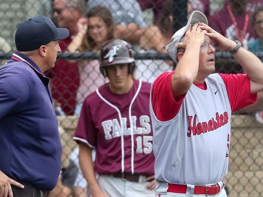 Coach Ernie Millard of Homestead reacts to a decision