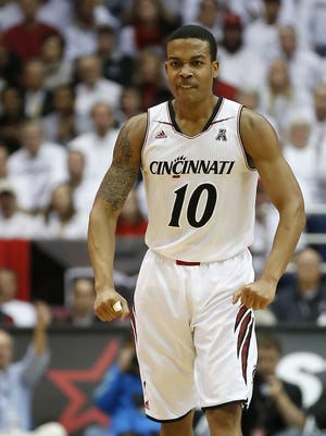 University of Cincinnati Bearcats guard Troy Caupin (10) reacts after dunking the ball during the first half against Connecticut.