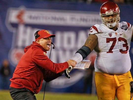 Clay Helton has a huge backer in 6-foot-8 offensive