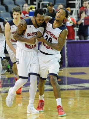 Southern Indiana guard Jeril Taylor (1) and teammate Cortez Macklin (30) celebrate after an 85-81 win over Kentucky Wesleyan in the Small College Basketball Hall of Fame Classic at the Ford Center in Evansville on Nov. 19, 2016.