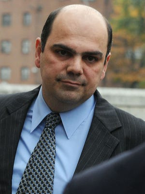 Former Dutchess County surgeon Spyros Panos exits federal court in White Plains on Oct. 31.
