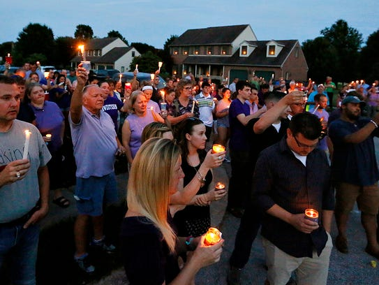A candlelight vigil is held in honor of Amanda Strous,